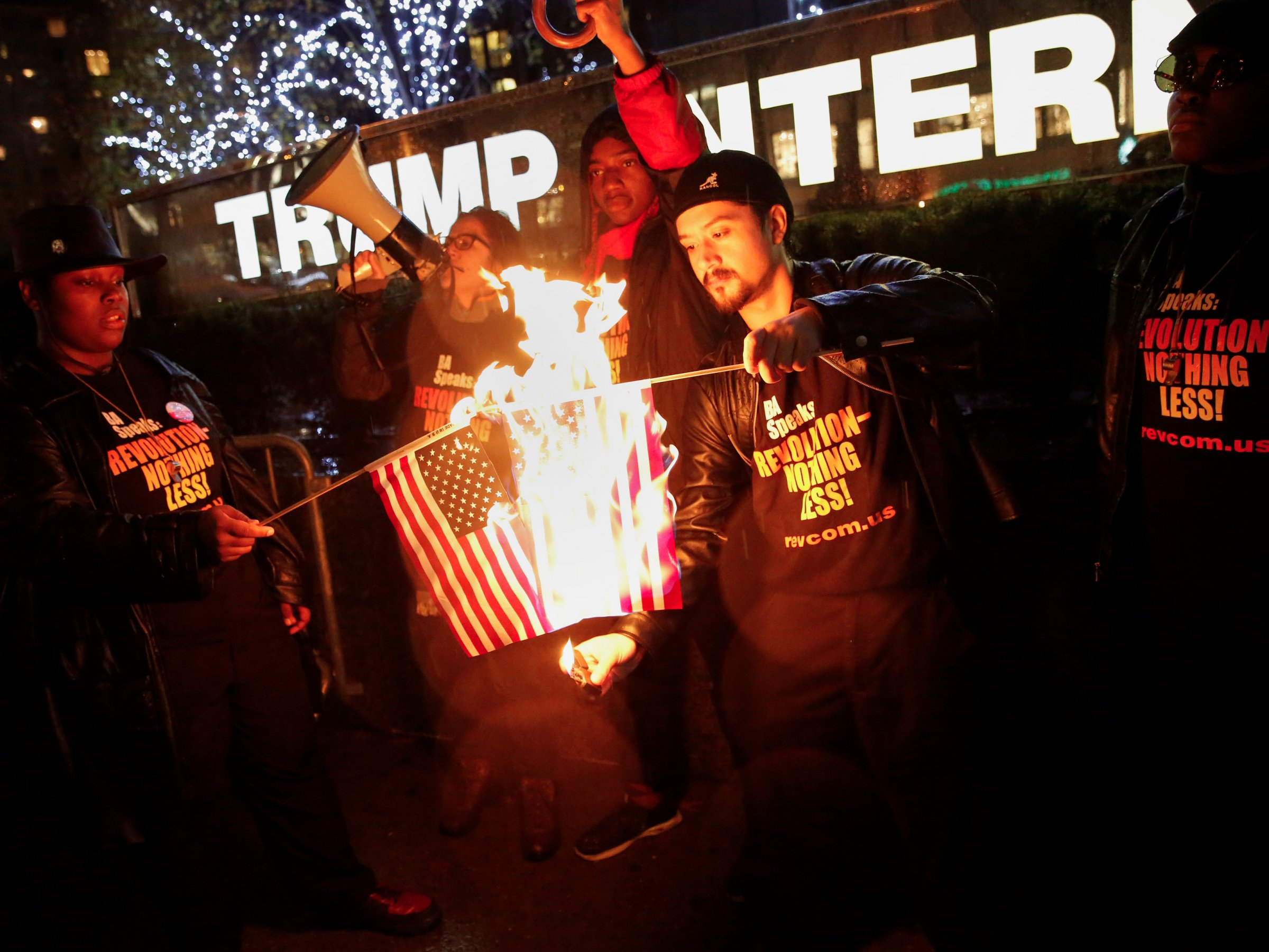 Activists burn the US flag in front of Trump Tower in New York City