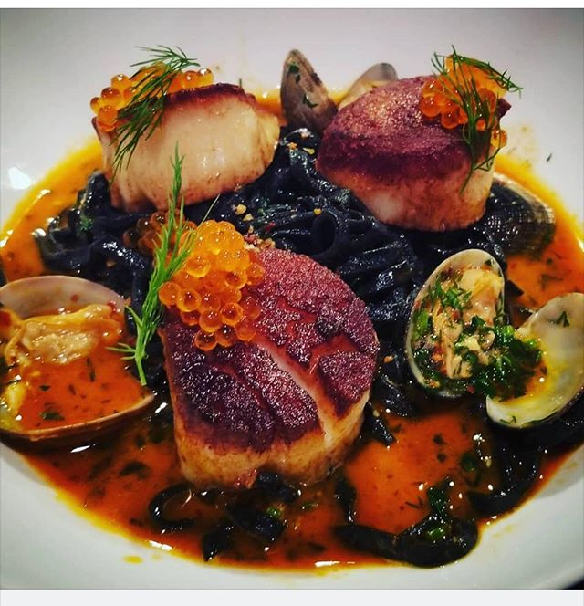 Sea scallops, clams, trout roe, nudja broth, squid ink linguini. #chef #steamboatsprings #chefsroll #steamboatdining #cheflife #italiano #mambosteamboat #seafood #pasta #freshpasta #christmas #foodie #foodies #food #foodpic #pic #instagood #instagram #foodporn