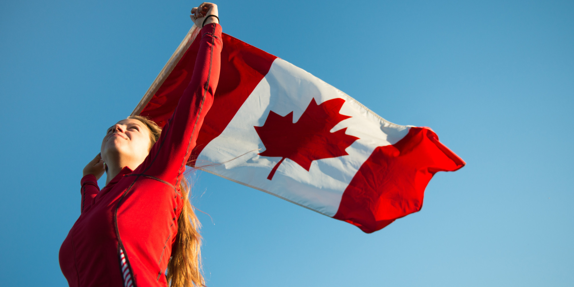 o-TEEN-HOLDING-CANADIAN-FLAG-facebook.jpg