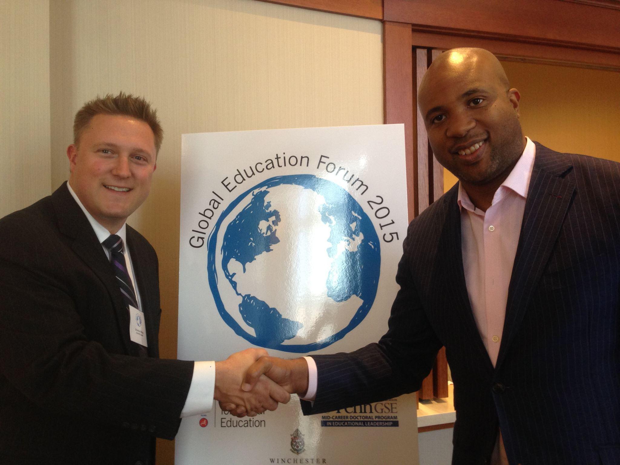 Congratulatory handshake with Dr. Brandon Wiley, former Executive Director of Asia Society