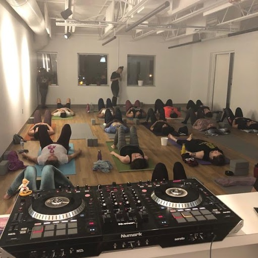 Joanna Brooks, Owner and CEO of Embody Yoga instructs a class during one of her sold out special events.