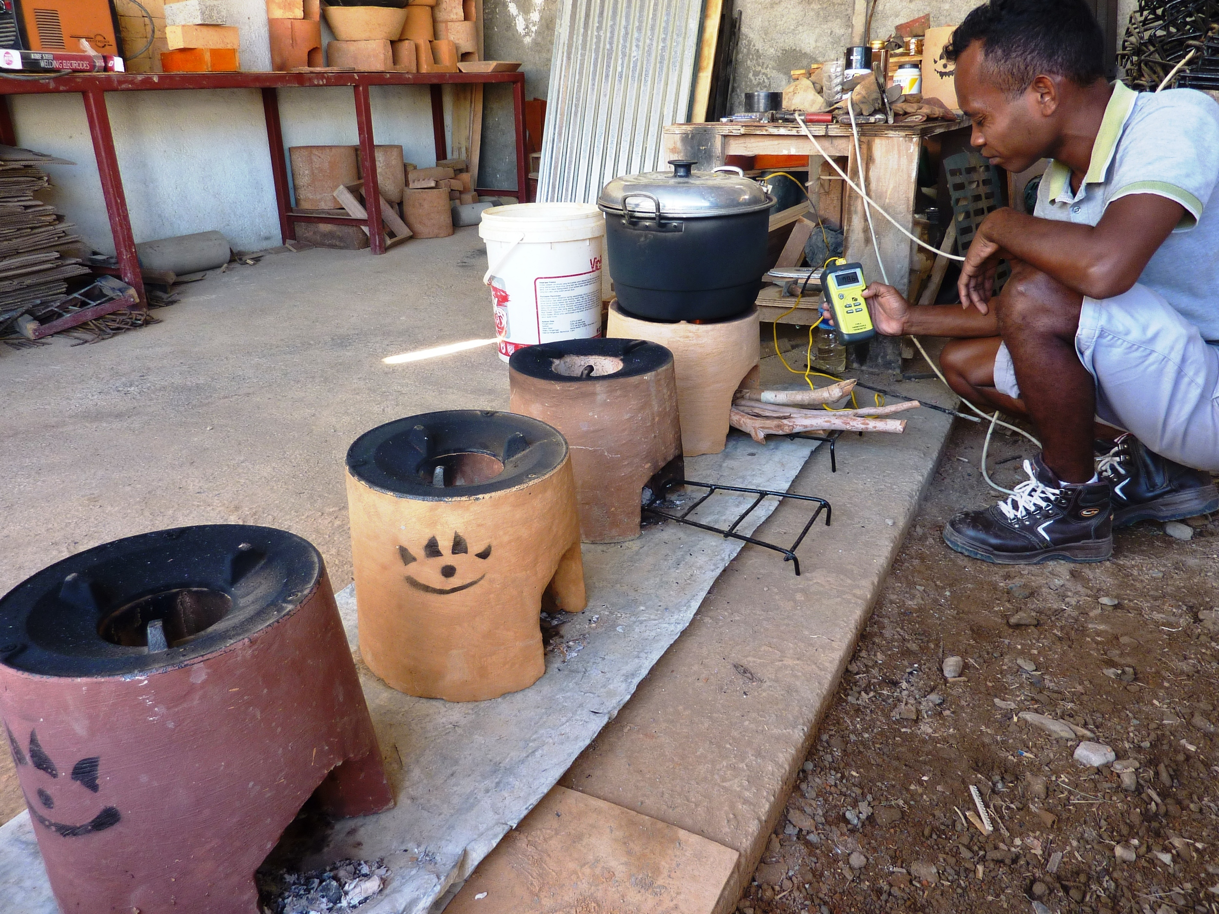 Sabino testing 4 different Cook Stoves.jpg