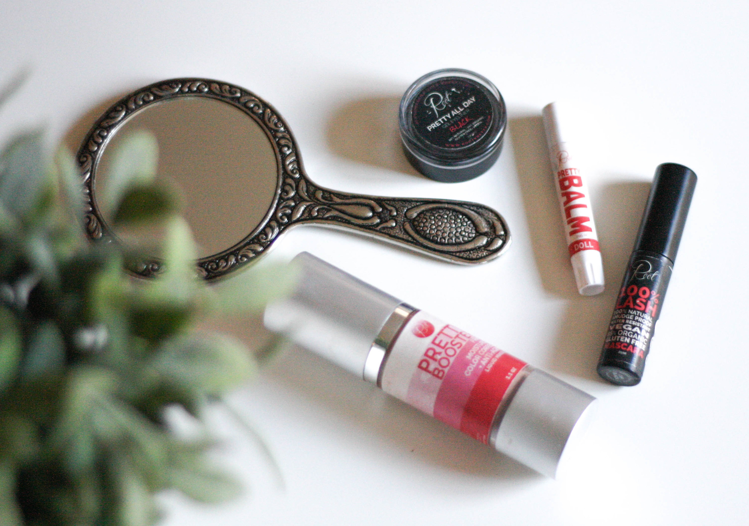 Pretty Booster, 100% Lash mascara, Doll pretty balm, + Pretty All Day gel eyeliner, above.