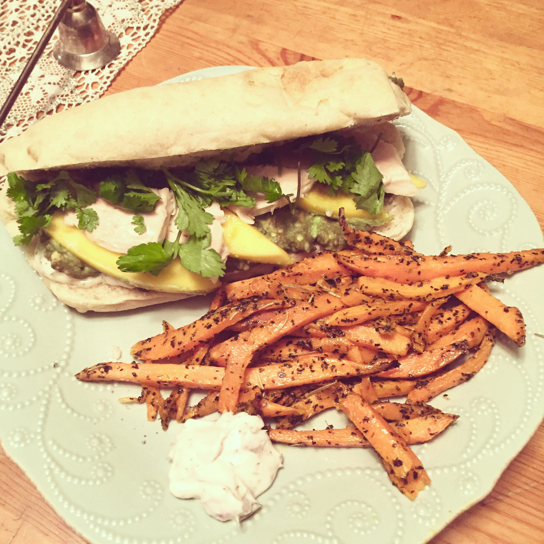 Mango avocado chicken sandwich and sweet potato fries!