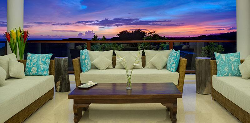 pandawa-cliff-estate-villa-rose-balcony-sitting-area-at-sunset.jpg