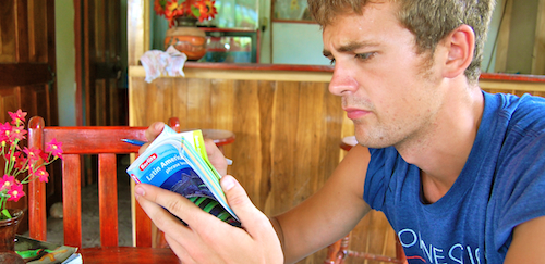 Casey studying his guidebooks