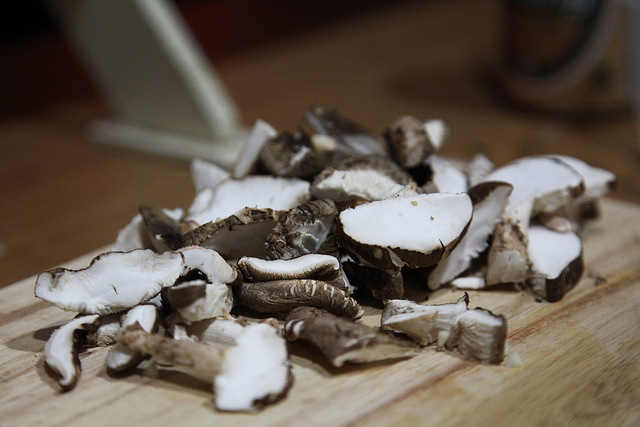 Chopping mushrooms in Chiang Mai, Thailand, cooking