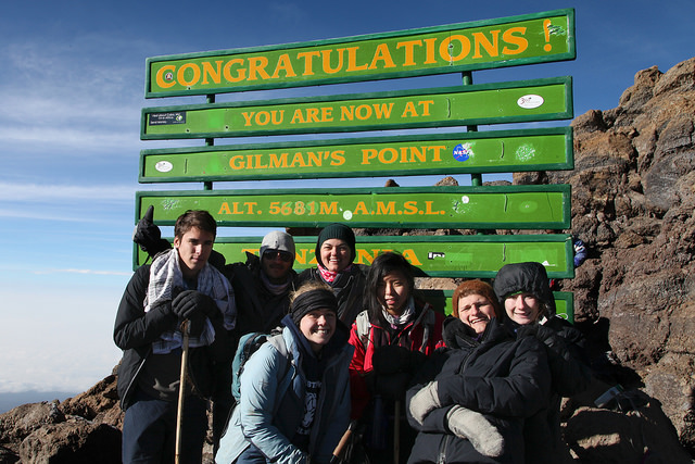 Lindsay summiting Kilimanjaro at Gilman's Point with students of THINK Global School, Tanzania