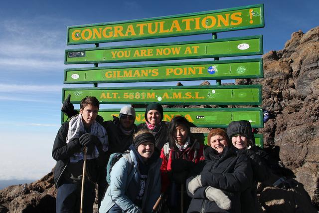 Lindsay summiting Kilimanjaro at Gilman's Point with students of THINK Global School, Tanzania