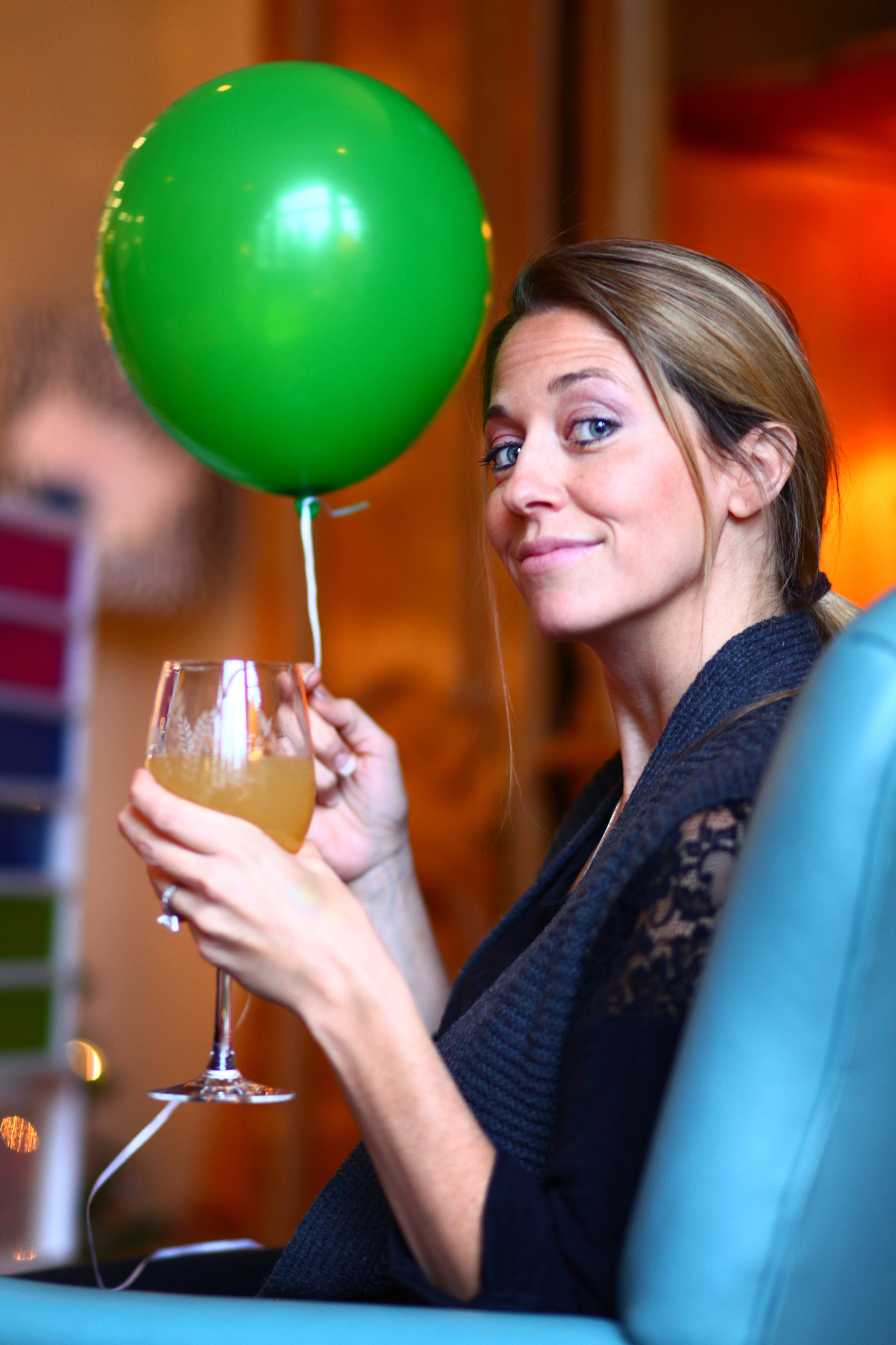 Allison with her wine and balloon, Christmas, 2014