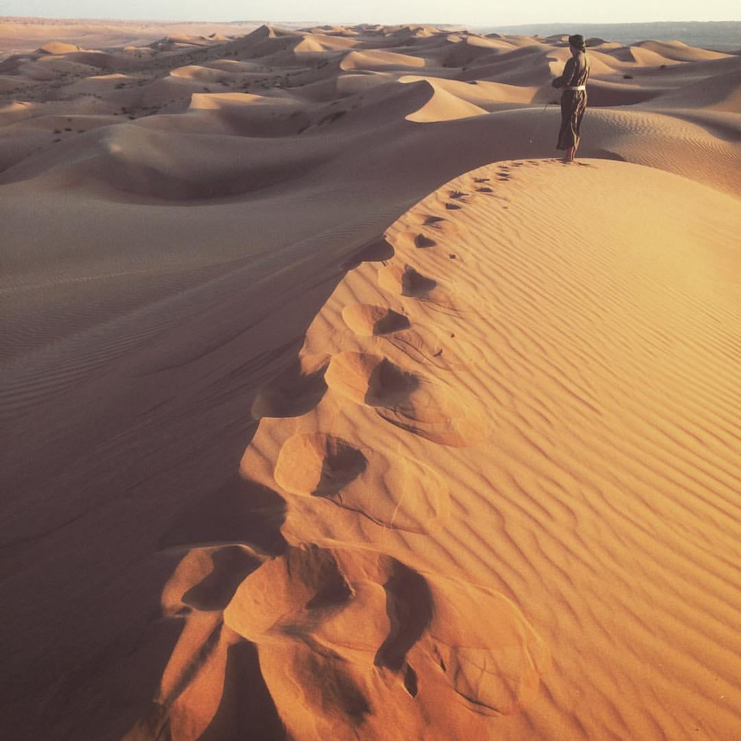 Nick in full Bedouin garb on the dunes of Wahiba Sands