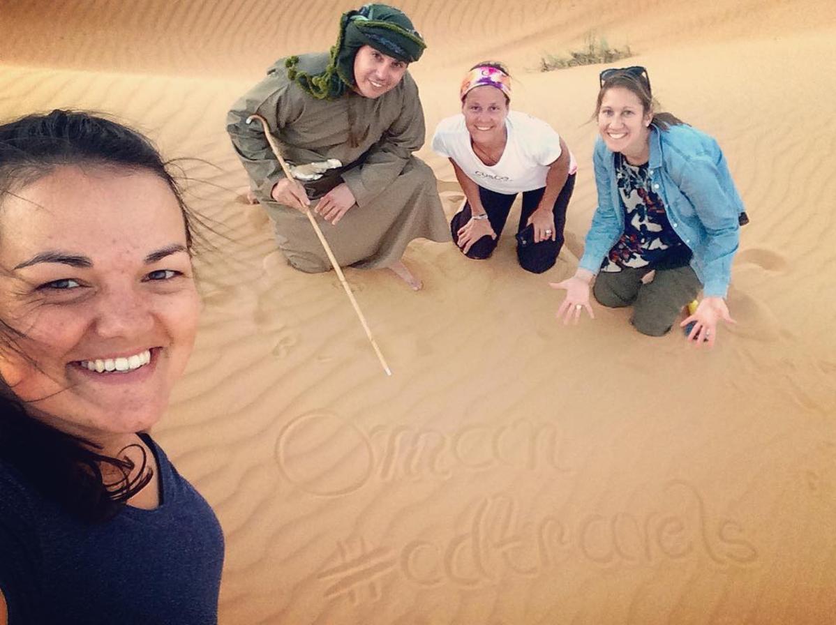A team selfie while watching a desert sunset