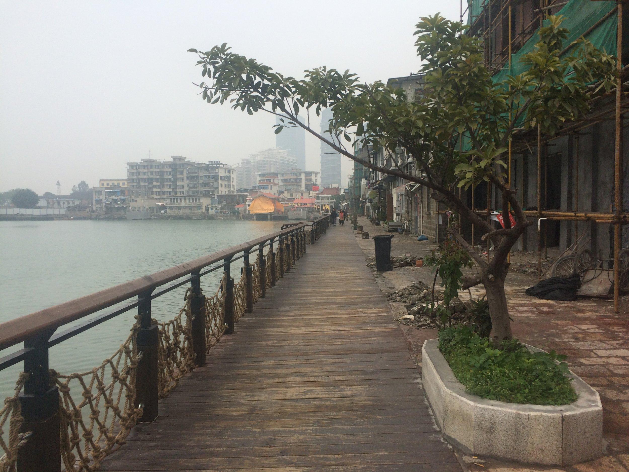 Walking the streets of Xiamen on a misty morning