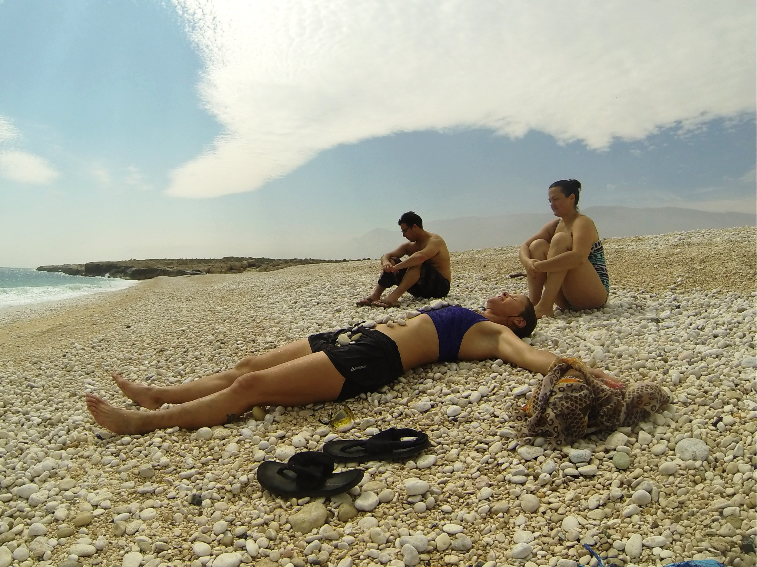 Drying off from an impromptu swim in the Gulf of Oman