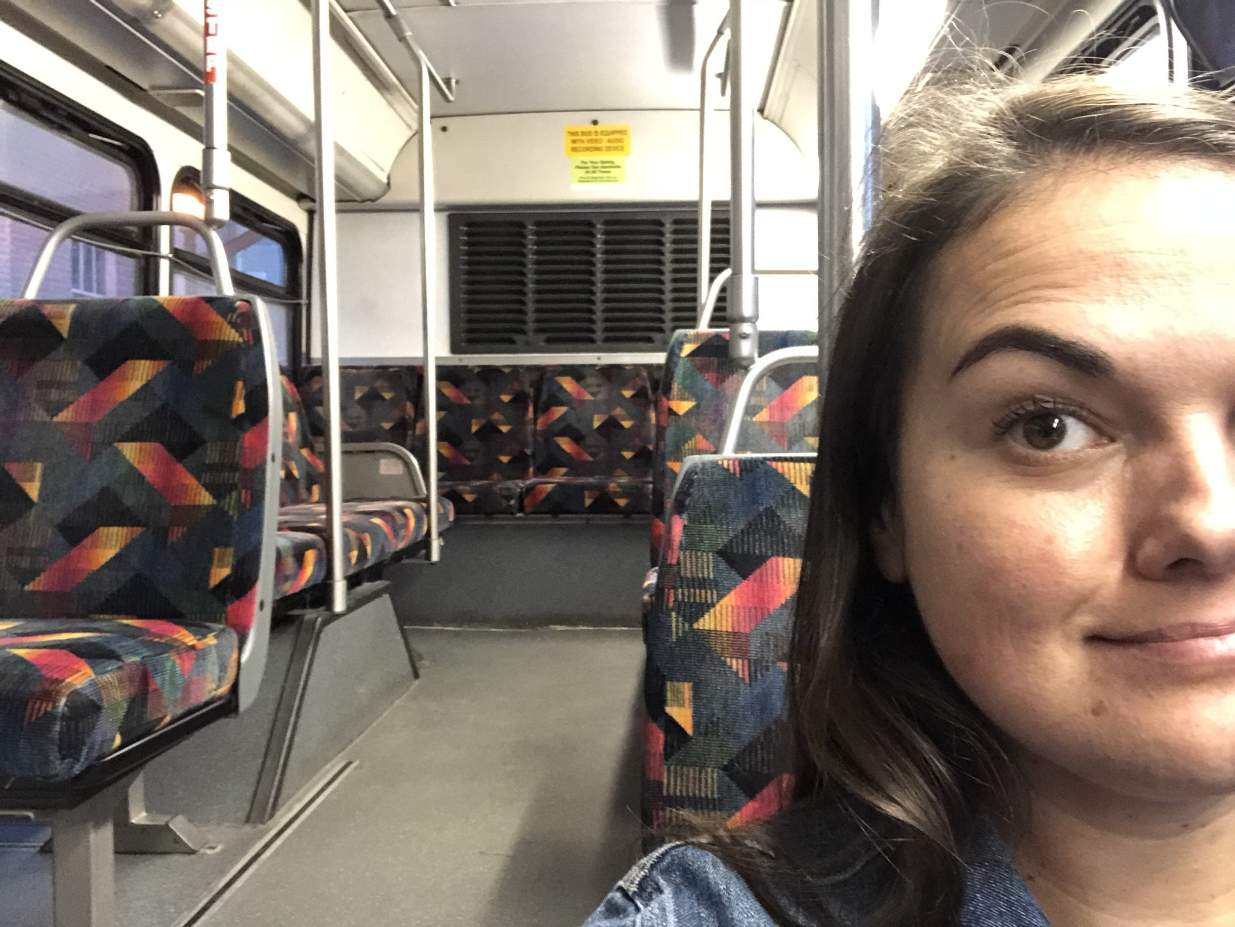 Lindsay on a bus in Denver