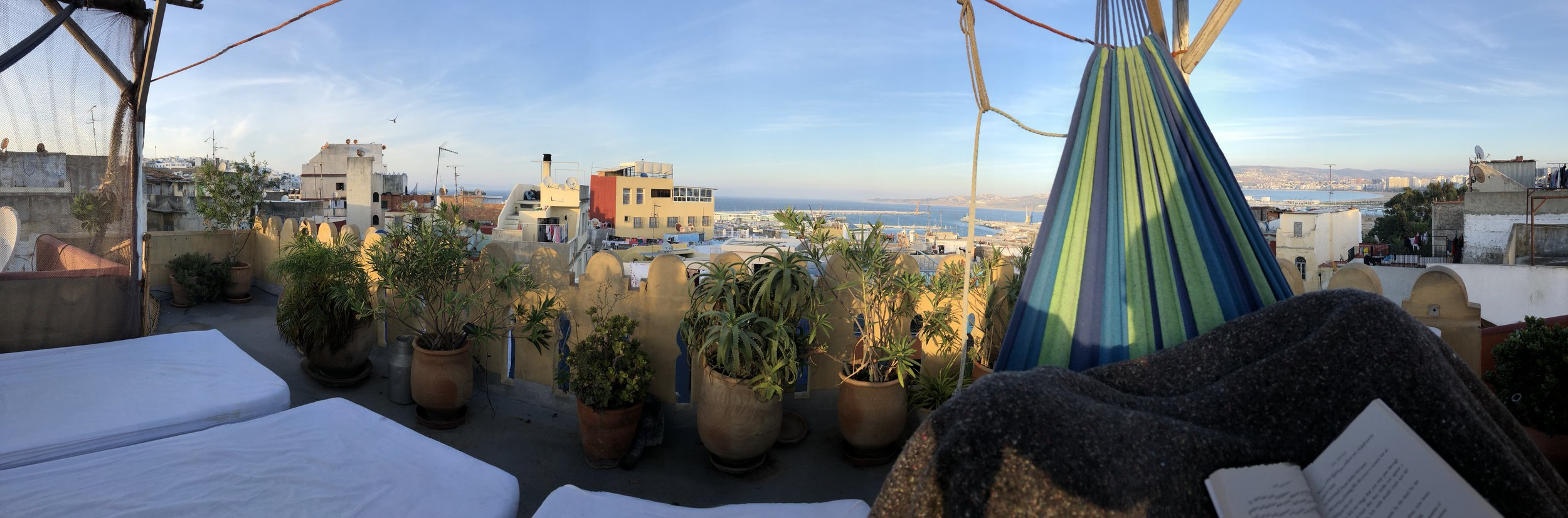Reading Khalil Gibran's The Prophet on the rooftops of Tangier, Morocco