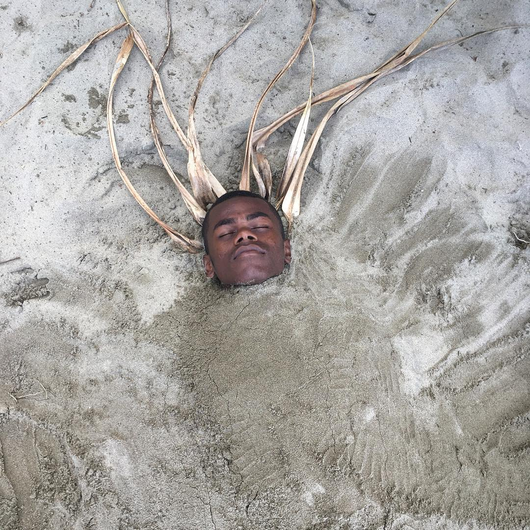 Waisale buried on the beach