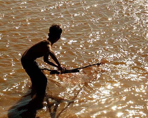 Alicia Morga Cambodia boy fishing
