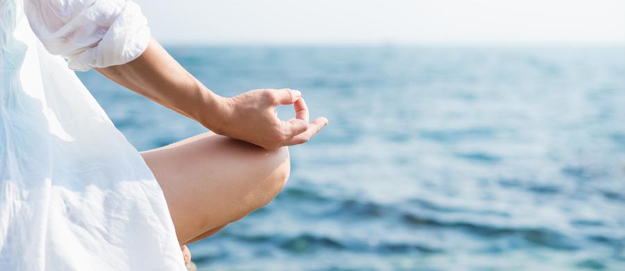 bigstock-Woman-meditating-at-the-sea-84557636.jpg