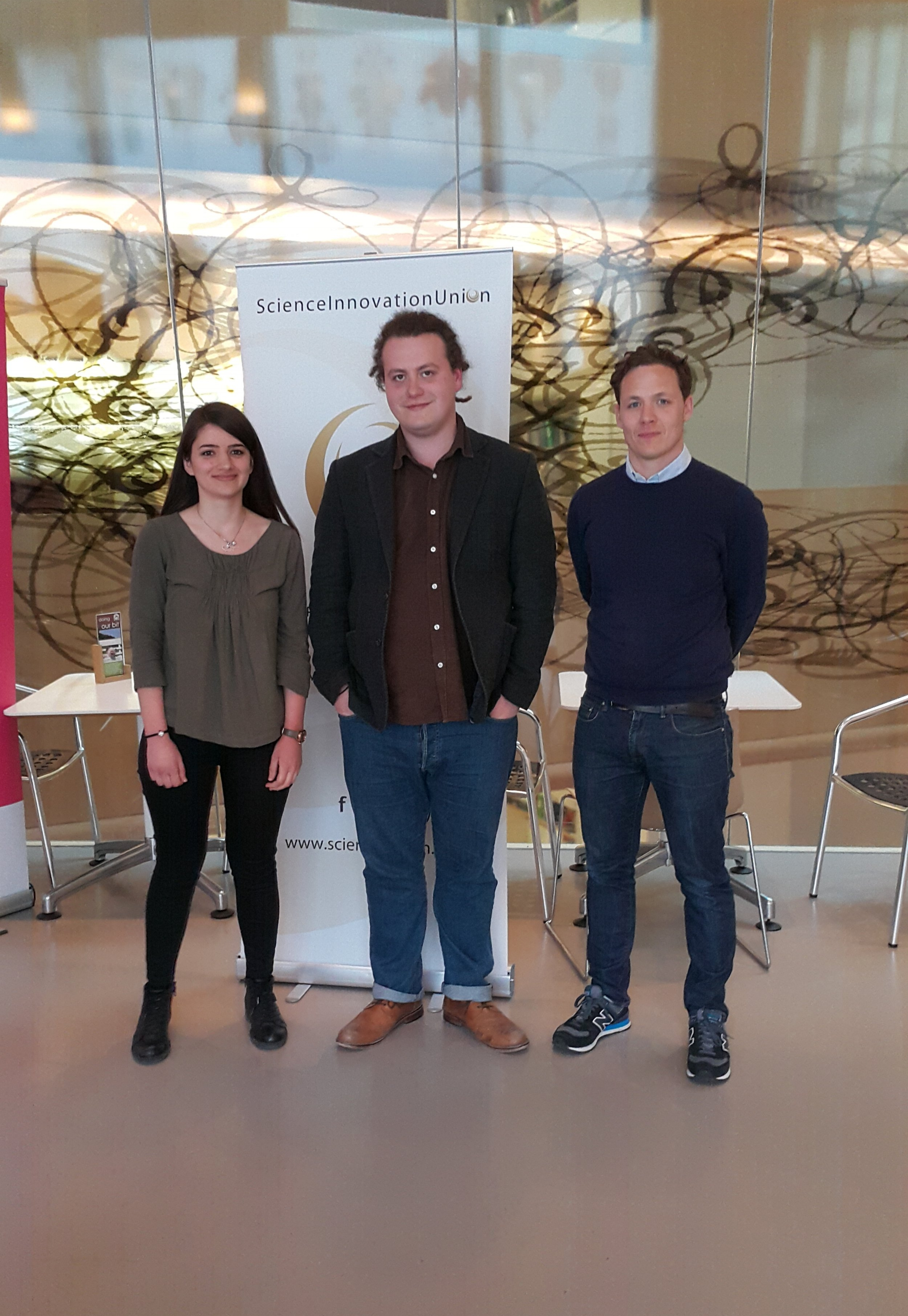 Our writing competition winners Idil Cazimoglu (left) and George Busby (right) with Naturejobs editor Jack Leeming