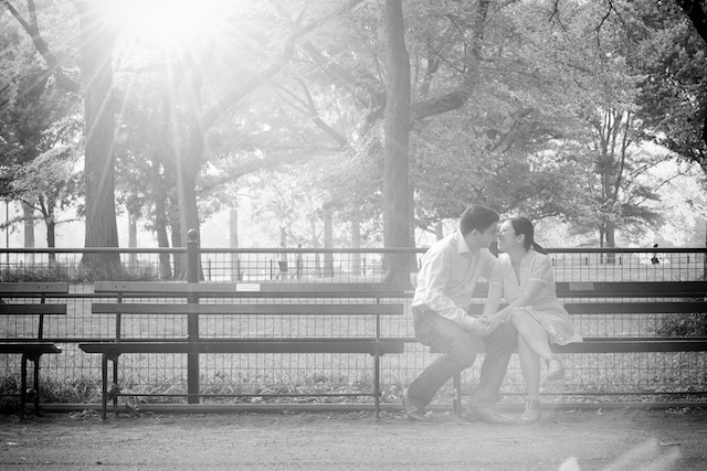 Pre-wedding session photo taken on a Central Park bench in New York City
