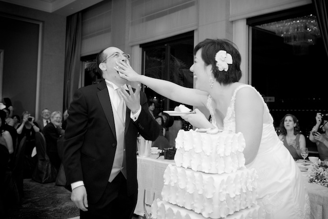 wedding cake shoved in groom's mouth