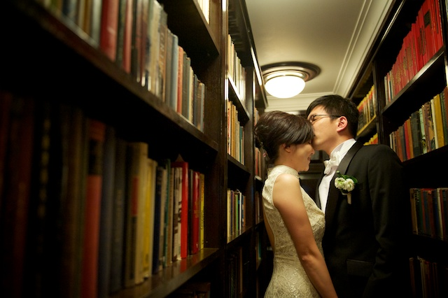 Hong Kong newlyweds kissing in the library room of China Club