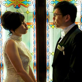 HK wedding couple at China Club, in front of stained glass 2