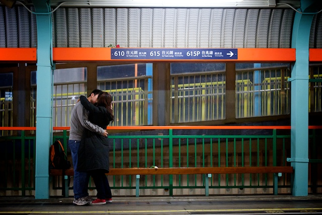 light rail station marriage proposal, kissing