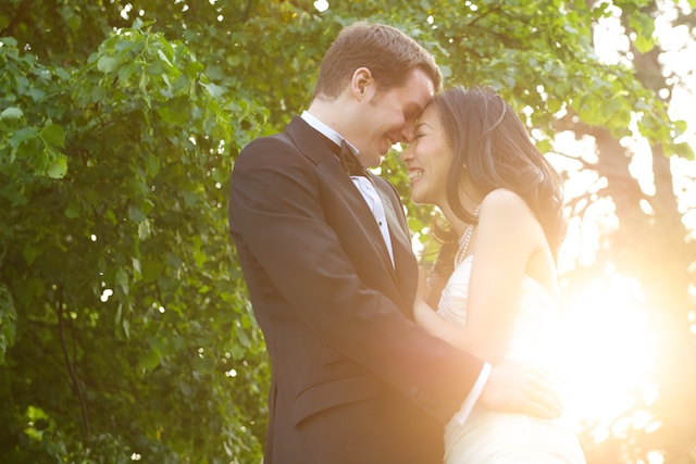 destination wedding in london, bride and groom formal portrait with sun starburst