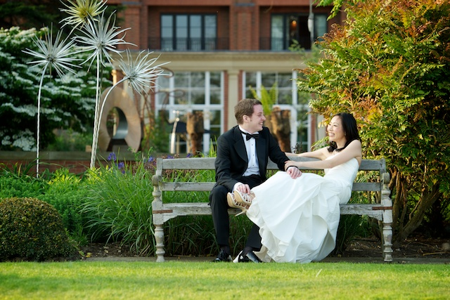 london wedding japanese bride german groom formal portrait grass bench
