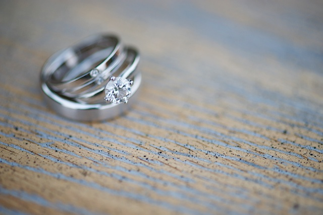 Hong Kong Wedding rings engagement rings on wooden table