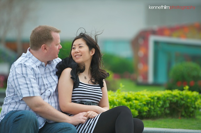 Hong-Kong-engagement-session-portraits-couple-ifc-mall-rooftop-outdoor-groom-bride-sitting-smiling