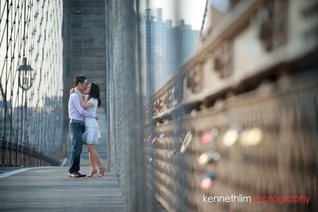 New York engagement photoshoot couple Brooklyn Bridge kissing