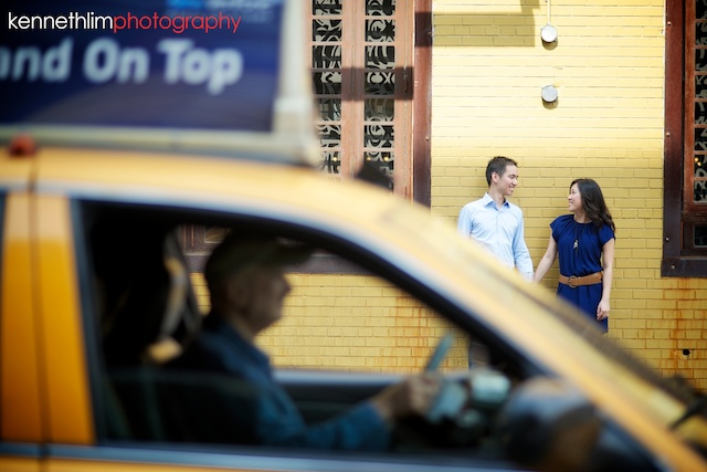 New York engagement photoshoot couple yellow wall taxi