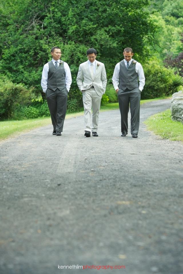 New York wedding outdoor groomsmen portrait walking