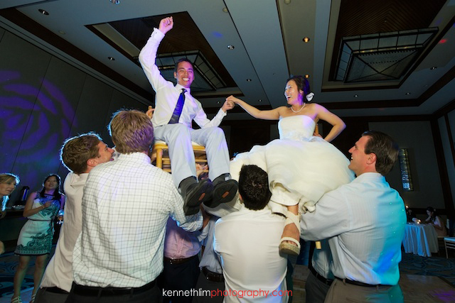 Kona Hawaii US Wedding bride groom dancing carried on chairs celebrations