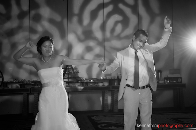 Kona Hawaii US Wedding bride groom first dance hands in air black and white
