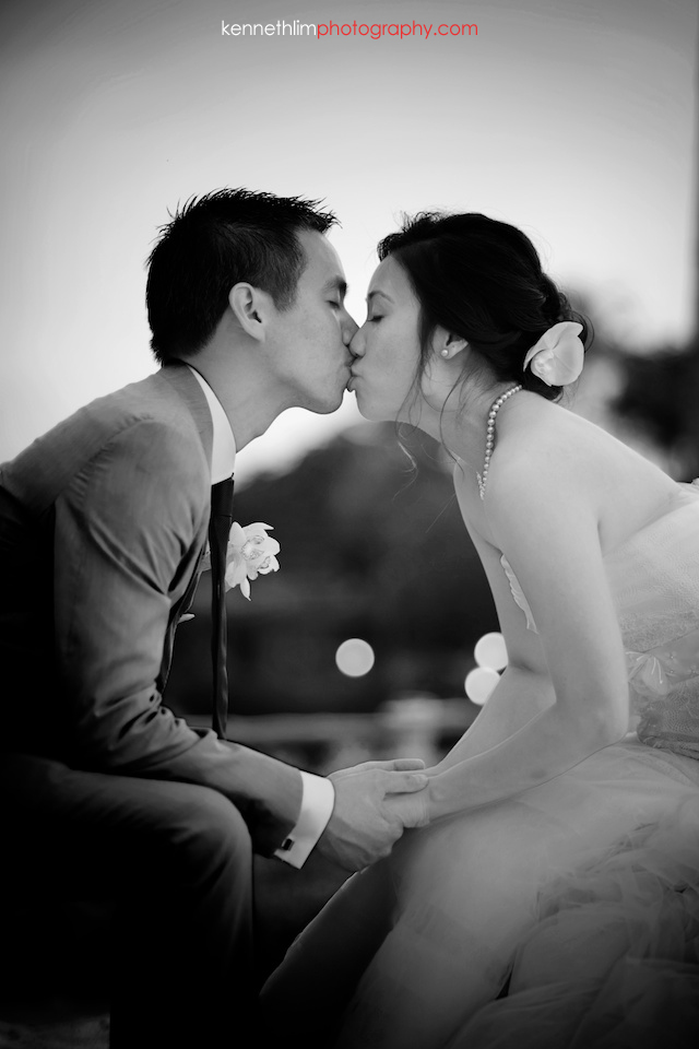 Kona Hawaii US Wedding outdoor bride and groom portrait session kissing black and white