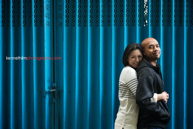 Hong Kong Midlevels engagement photoshoot session portraits couple hugging from behind blue gate