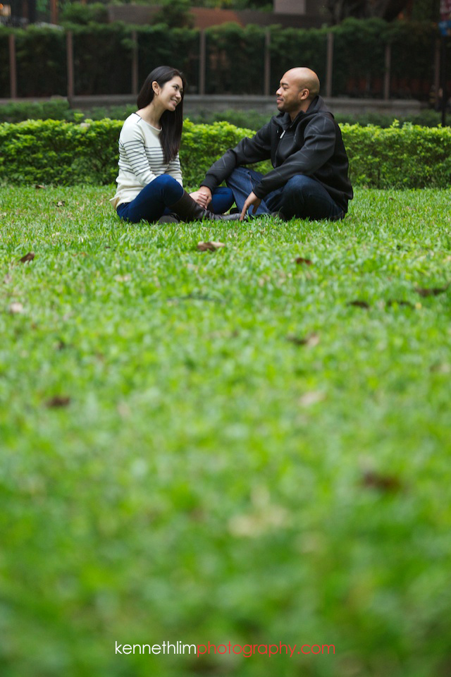 Hong Kong Midlevels engagement photoshoot session portraits couple sitting on grass