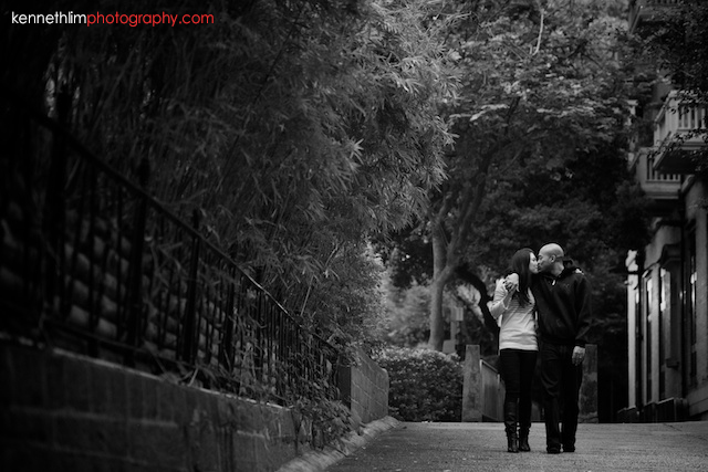 Hong Kong Midlevels engagement photoshoot session portraits couple walking holding hands kissing black and white