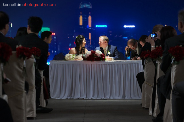 Hong Kong The Peninsula wedding bride and groom smiling at signing table