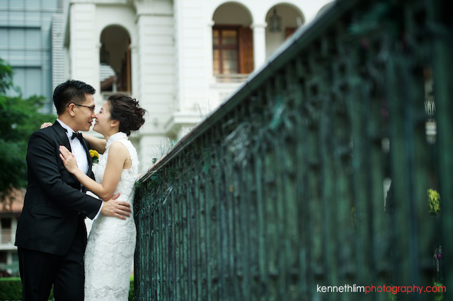 Hong Kong 1881 Heritage engagement photoshoot bride kissing groom leaning