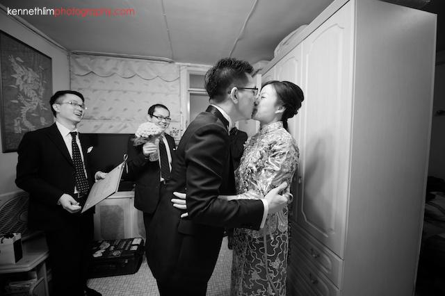 Hong Kong wedding morning groom bride kissing after games