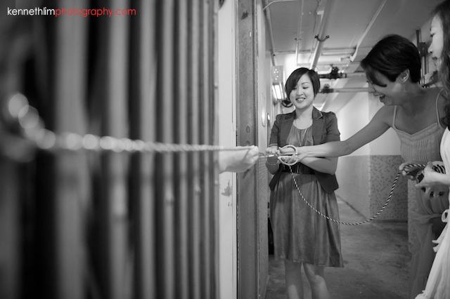 Hong Kong wedding morning preparations bridesmaid setting up laughing