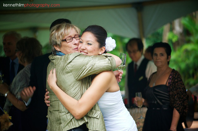 Hong Kong Country Club wedding bride hugging guest happily
