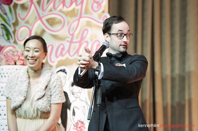 Hong Kong wedding Four Seasons banquet MC showing magic trick to audience