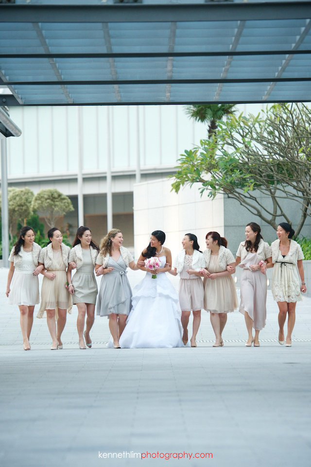 Hong Kong wedding Four Seasons reception portrait session bride with bridesmaids laughing arms locked