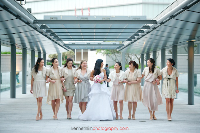 Hong Kong wedding Four Seasons reception portrait session bride with bridesmaids laughing walking hand in hand